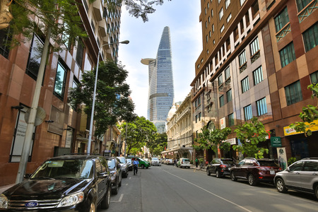 Hochiminh City Vietnam June 6 2015: a street in downtown HCM tower overlooking the Bitexco Financial Tower stands at an altitude of 262.5 meters it is the second tallest building in the world 124