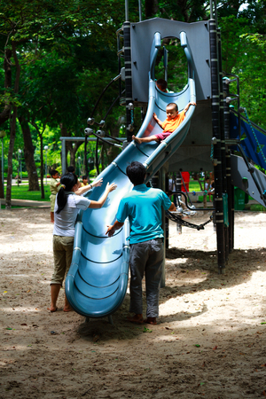 armbands: Ho Chi Minh City, Vietnam - June 21, 2015: unidentified, cute baby playing alone in the flume slide park in Ho Chi Minh City, Vietnam