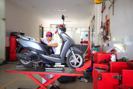 Hochiminh City, Vietnam - June 23, 2015: Professional motorcycle repairman at a service center of Honda motorcycles in Ho Chi Minh City, Vietnam Editorial