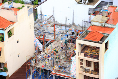 authorities: Hochiminh City, Vietnam - June 25, 2015: Civil housing construction in Ho Chi Minh City, Vietnam Editorial