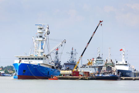 truck crane: Hochiminh City, Vietnam - June 27, 2015: Transportation for export, at Cat Lai port on Sai Gon river import, boat crane to load containers, this is big harbor for trade service industry, Vietnam
