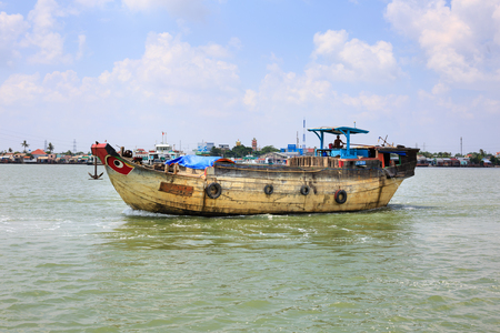 freshwater sailor: Ho Chi Minh City, Vietnam - June 27, 2015 - a large wooden boat on a river active in Hochiminh City, Vietnam