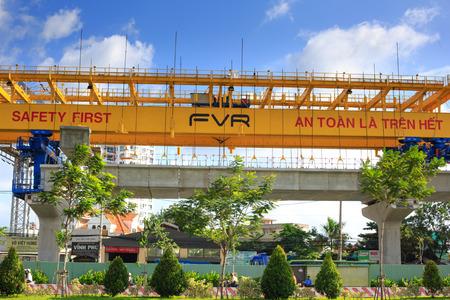 beton: Hochiminh City, Vietnam - July 2, 2015: giant crane hoisting the beam beton up the Pillars, prepare for subways lines