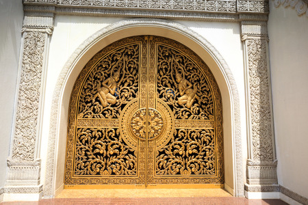 recluse: Ho Chi Minh City, Vietnam - July 2, 2015: the main gate of the Buddhist Temples Buu Long in Ho Chi Minh City, Vietnam. This very heavy gates, cast bronze and gilded Editorial