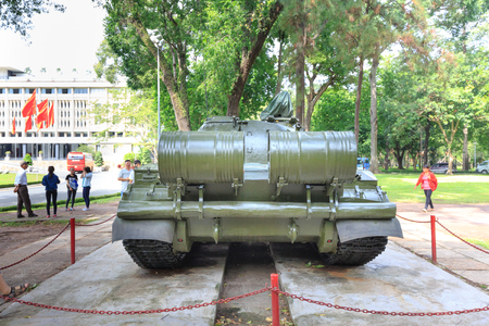 remnants: Hochiminh City, Vietnam - July 8, 2015: the first tank through the gates burst of the Independence Palace at the end of Vietnam War April 30th, 1975 at Ho Chi Minh City, Vietnam. After April 30, 1975 is known as Reunification Palace Editorial