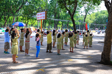 scouts: Hochiminh City, Vietnam - July 5, 2015: A weekly gatherings of unknown Scouts camping in a city park in HoChiMinh, Vietnam Editorial