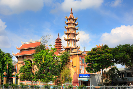 Ho Chi Minh City, Vietnam - June 9, 2015: an ancient temple city in HoChiMinh with 9-storey tower. Buddhism is the official religion in Vietnam