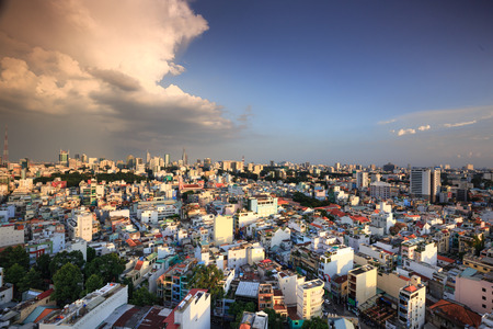 The landscape of Saigon: Hochiminh City, Vietnam - July 24, 2015: Saigon or Ho Chi Minh city skyline in sunset with colorful houses, Saigon is the largest city in Vietnam with around 10 million population people. biên tập