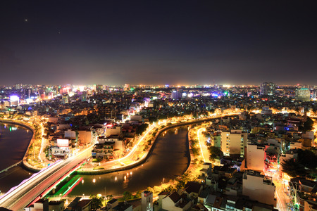 loc: Hochiminh City, Vietnam - July 24, 2015: Saigon riverside with the road across the canal and houses Multiple Loc, Ho Chi Minh City, Vietnam. The shape look like a archery