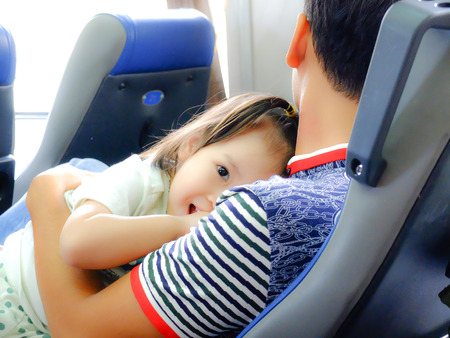 looked: Da Nang city, the Vietnam - April 27, 2015: Unknown. on a train from Danang to Saigon. little girl in the arms of her Artist Looked very happy father. She Looked Into the camera lens with wide eyes