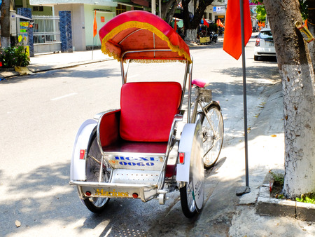 to prefer: Da Nang city, Vietnam - April 28, 2015: portrait of a cyclo in Danang, Vietnam. Tourists prefer more traffic means again cyclo