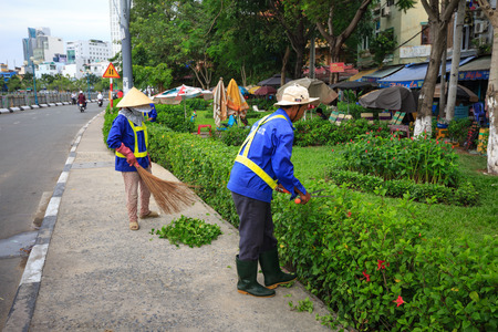cleaning team: Hochiminh City, Vietnam - August 8, 2015: Unidentifield. Workers are pruning off branches environment of scrubs in a neighborhood in HoChiMinh city. a normal job but the significant Editorial