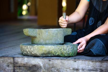 flour mill: flour mill and stone woman