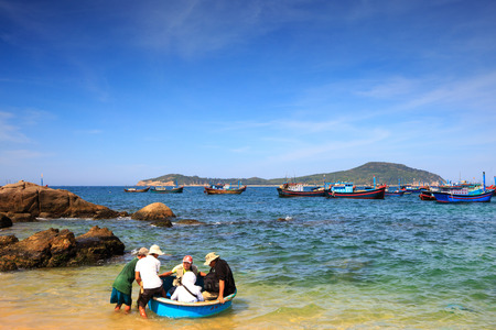 Phuyen province, Vietnam - August 16, 2015: some unidentified tourists who l on the basket rowing boat to visit the island by fisherman overthere