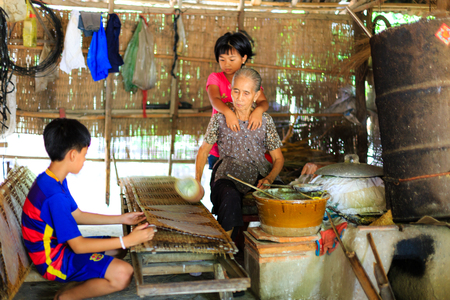existed: Cu Chi District, Hochiminh City, Vietnam - September 27, 2015: The Daily Activities of the People living in village m produces rice paper. This career has existed for a long time