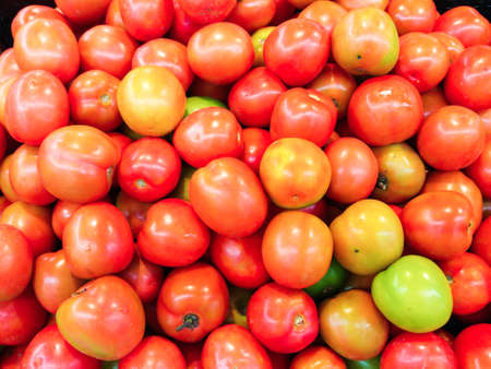 soft sell: Vietnamese selling tomatoes at market Stock Photo
