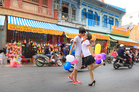 bustling: Hochiminh City, Vietnam - September 26, 2015: view of the busy and bustling street mid-autumn festival. Mid-Autumn Festival is a celebration of the full moon in August every year of Vietnam Editorial