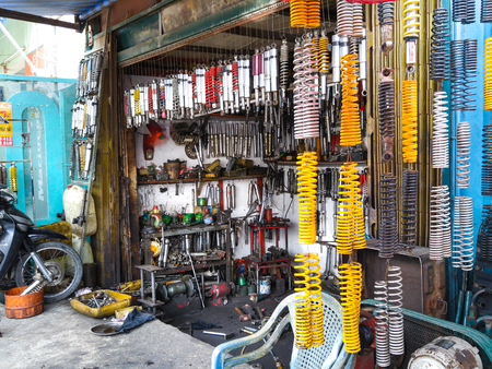 suppressor: Hochiminh City, Vietnam - October 6, 2015 in a print shop specializing repair and restoration of motorcycle shock absorber, shock absorber parts m Damaged or after a period of use v roads in Vietnam have not been good