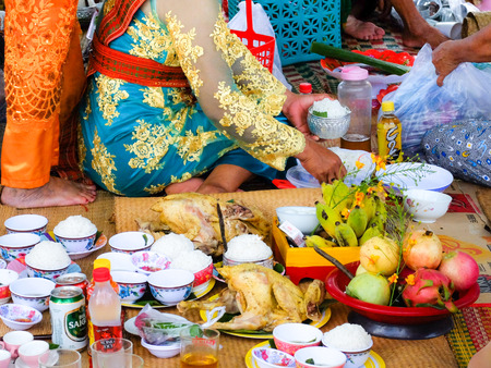 restless: Phan Rang city, Vietnam - October 12, 2015: scene of the delicious dishes to prepare to ask for ask for ask for their ancient gods Restless at Poklong offer Girai tower. They are here in the Annual Kate festival, The Most Important m Ceremony of Cham Brah
