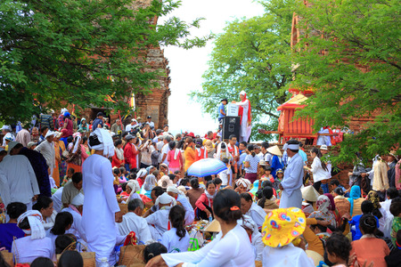 restless: Phan Rang city, Vietnam - October 12, 2015: scene of the delicious dishes to prepare to ask for ask for their restless at ancient gods offer Poklong Girai tower. They are here in the Annual Kate festival, The Most Important m Ceremony of Cham Brahmanmo