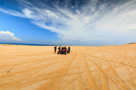 terrain: Ninh Thuan province, Vietnam-October 11, 2015: a group of tourists to explore the prepared sand dunes are the Mui Dinh at the seaside, Binh Thuan Province by coach terrain vehicles Editorial