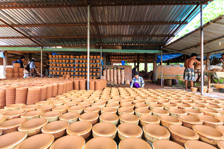 craftswoman: Binh Duong province, Vietnam - October 25, 2015: Ceramic base at Binh Duong province, Vietnam: Inventory of finished ceramic products