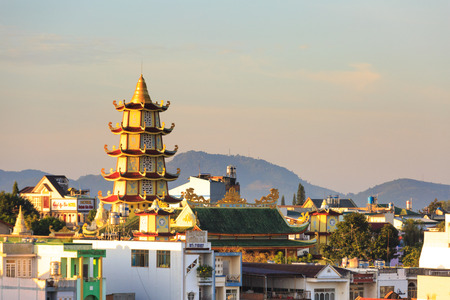 loc: Bao Loc town, Vietnam - October 29, 2015: Beautiful ancient temple on summers day in Bao Loc, Vietnam, views of the Bao Loc town seen from above, it is a nice, peaceful small town located on the plateau Di Linh, Lam Dong province