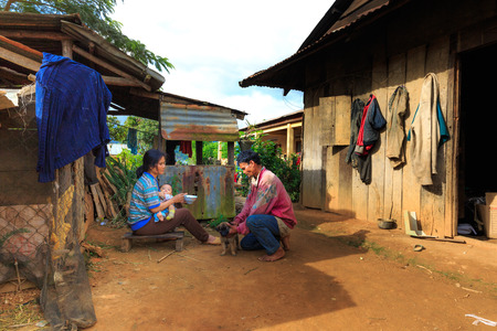 old asian: Lam Dong Province, Vietnam - November 7, 2015: A view of daily life in the family from Minority ethnic highlands. Minorities and ask for their ethnic couples wooden house