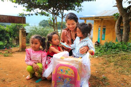 poverty relief: Lam Dong Province, Vietnam - November 7, 2015: A joy after Receiving gifts of ethnic Minority children in the highlands. All the gifts come from a society charity group
