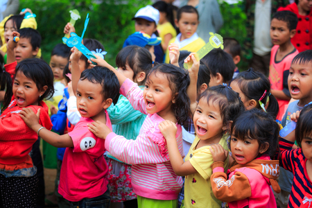 Lam Dong Province, Vietnam - November 7, 2015: A joy after Receiving gifts of ethnic Minority children in the highlands. All the gifts come from a society charity group