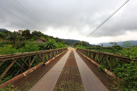 highlands region: Lam Dong Province, Vietnam - November 7, 2015: This is the iron bridge was built over many years, it is located on the road leading up the mountain where many Minorities live