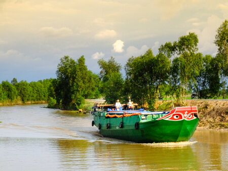 means of transportation: Moc Hoa District, Long An Province, Vietnam - November 22, 2015: a freighter ship on the river. This is one of the main means clustering of transportation in the Mekong Delta of Goods of Southern Vietnam Editorial