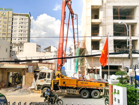 thriving: Ho Chi Minh city, Vietnam - December 2, 2015: a dedicated vehicle is pumping fresh for building a residential house beton. The construction of housing and business in this city is Thriving