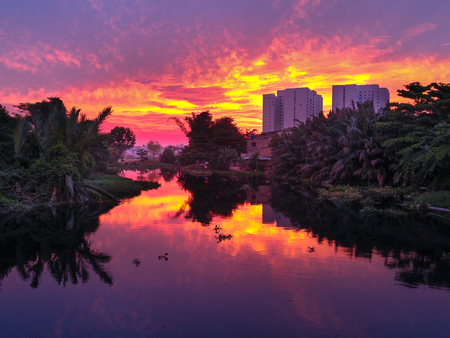 beautify: Hochiminh City, Vietnam - December 19, 2015: Sunset on NhieuLoc channel, this is the state canal Rehabilitation lot, Beautify for city Editorial
