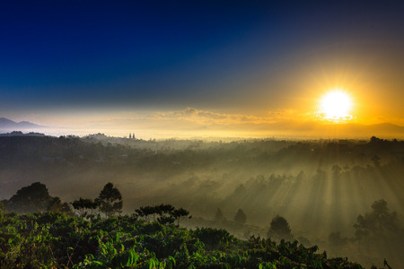 highlands region: foggy morning at baoloc City, Lam Dong Province, Vietnam. Baoloc is one of famous and beautiful cities for tourist. 1,200m above sea Its about leveling on the Langbian Plateau, Central Highlands region