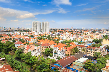 above 21: Hochiminh City, Vietnam - October 21, 2013: A view of HoChiMinh city panorama from above. This is a new residential area with many villas was built at a rapid pace beside the Saigon River.