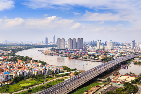 Hochiminh City, Vietnam - October 21, 2013: A view of panoramic Saigon Bridge on the SaiGonriver. This is a very important bridge, from the HoChiMinh city leads to the north provinces of Vietnam. It spans the Saigon River where container cargo ships cros