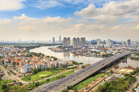 cros: Hochiminh City, Vietnam - October 21, 2013: A view of panoramic Saigon Bridge on the SaiGonriver. This is a very important bridge,  from the HoChiMinh city leads to the north provinces of Vietnam. It spans the Saigon River where container cargo ships cros