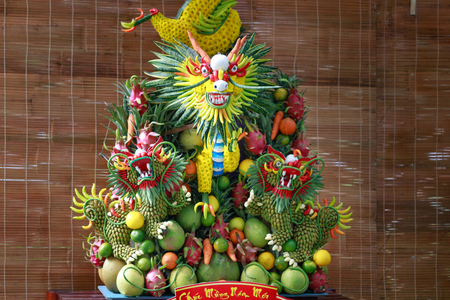 artisans: the dragon is crafted from fruit and vegetable by vietnamese Artisans