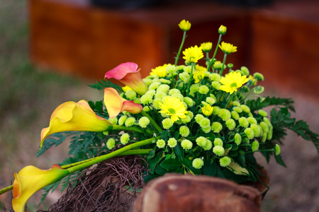 artisans: floral arrangement art basket with lily yellow daisies is made by artisans Stock Photo
