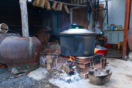 big pot boiled chung cakes during the Lunar New Year by traditional wood stove of the people who living in the villages of Vietnam
