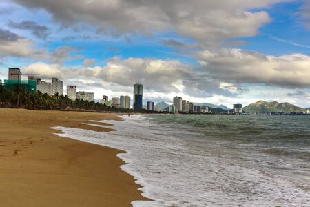 dangerously: Nha Trang beach with wave and beautiful blue sky, Vietnam.