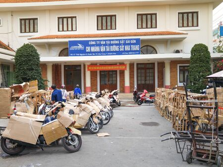 carefully: Nha Trang city, Vietnam - January 28, 2016 : the passengers motocycle is packed carefully to prepare to up train. The many means of transporting the cargo