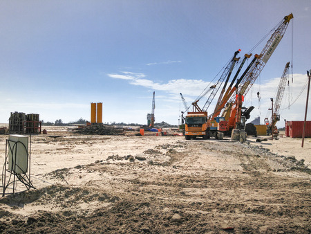 Nha Trang city, Vietnam - January 30, 2016 : Images of machinery, cranes, drilling machines pile on construction a luxury resort near to the seaside of Nha Trang city, Vietnam Editorial