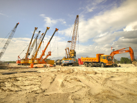boring rig: Nha Trang city, Vietnam - January 30, 2016 : Images of machinery, cranes, drilling machines pile on construction a luxury resort near to the seaside of Nha Trang city, Vietnam Editorial