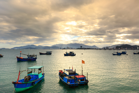 coastal city: Nha Trang city, Vietnam - January 28, 2016 : view picture of a fishing village with fishing boats of fishermen in the coastal city of Nha Trang, Vietnam