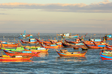 vietnamese: Nha Trang city, Vietnam - January 28, 2016: Fishing boats in the fishing village near NhaTrang city, Vietnam