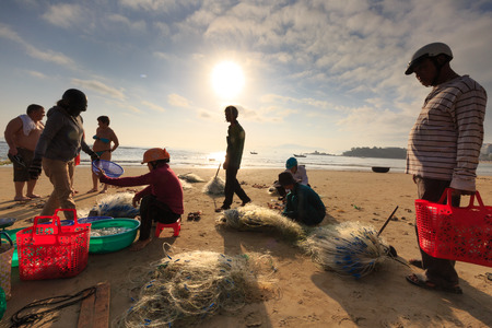 Nha Trang city, Vietnam - January 29, 2016 : Crowed atmosphere at outdoor seafood market on beach, views selling fresh fish right on the beach by the fishermen in the city NhaTrang, Vietnam Editorial