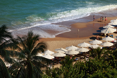 idling: Nha Trang city, Vietnam - January 31, 2016: view from above the beach with parasols and lounge chairs to relax in the coastal city NhaTrang, Vietnam