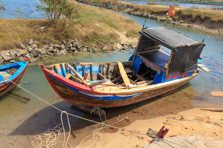 fishermens: Old fishermens boats on the beach in Phan Rang, Vietnam Stock Photo